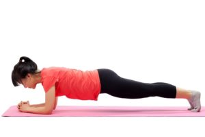 Woman doing plank exercise isolated on white background